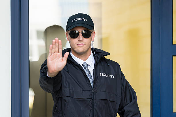 Male Security Guard Making Stop Sign With Hand - sipXcom